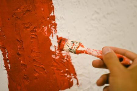 painting and decorating: Closeup on hand painting decorating using paint brush