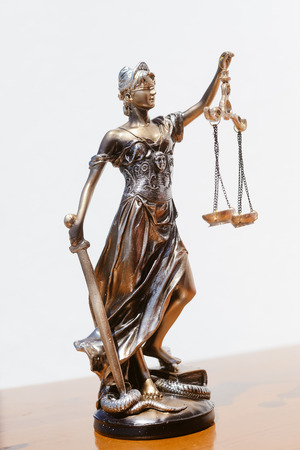 Symbol of justice statue on the white background