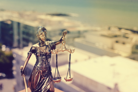 Lady Justice, statuette of the Themis goddess. Law concept