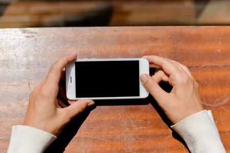 top 7: Closeup on smartphone in the hand, copy space background Stock Photo