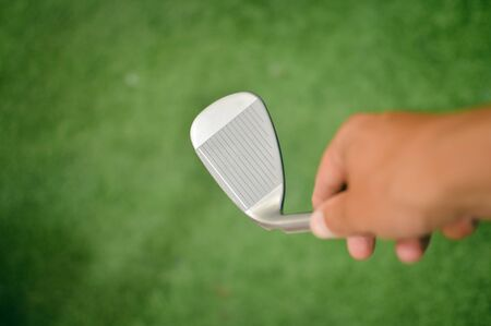 Closeup view of person holding in hand golf club during shoping.