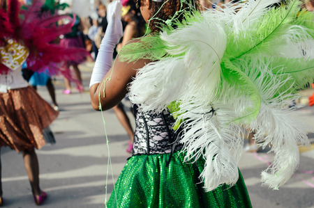 flashy: Dancers in costumes performing at the Carnival Parade on outdoors background Stock Photo