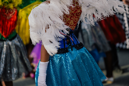 Dancers in costumes performing at the Carnival Parade on outdoors background Stock Photo