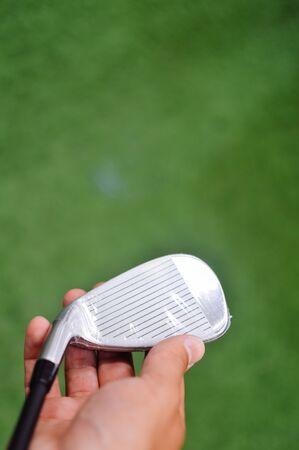 prestigious: Golf club in hand, green copyspace background