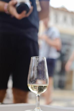 Albufeira, Portugal - August 03, 2016. Person waiter host presenting a wine bottle for tasting