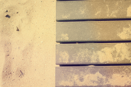 boardwalk trail: Top view on vintage planked wood and beach sand background