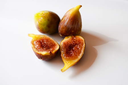 Close up view of figs on white table background Stock Photo