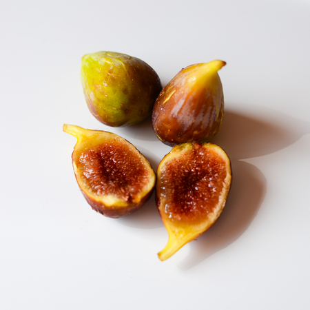 exclusive photo: Close up view of figs on white table background Stock Photo