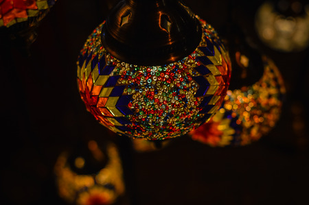 Colorful blurry shiny background of illuminated beautiful lighting lamps, closeup view Stock Photo
