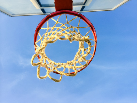 Basketball basket net on blue sky outdoors background