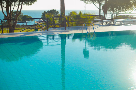 Blue water of outdoor swimming pool luxury leisure lifestyle background. Travel vacation destination Stock Photo