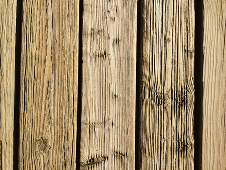 rusty nail: Closeup on wooden board background