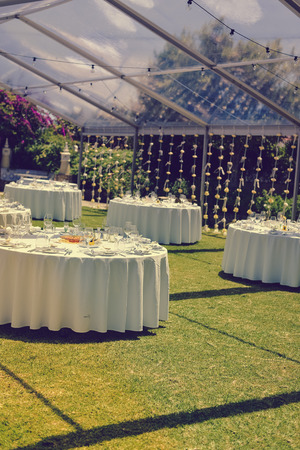 Decorated celebrating event table on sunny day outdoors background
