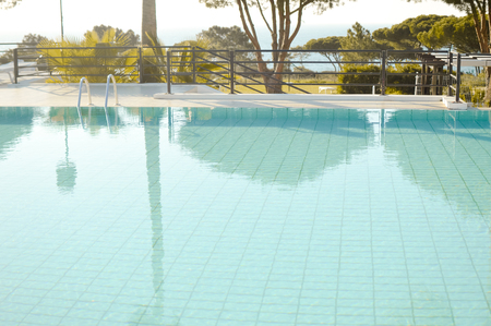 property ladder: Open air swimming pool blue surface background