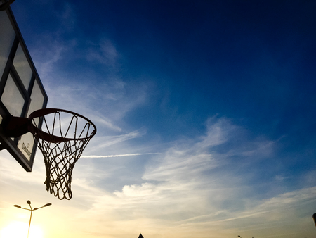 rim: Blue sky and basketball hoop outdoors background