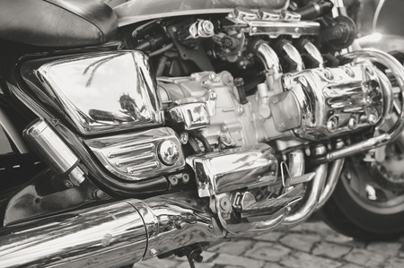 grille: Close up on shiny chrome motorcycle details, silver background