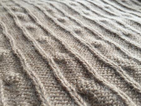 cable stitch: Close-up photo of knitted crumpled textured surface background
