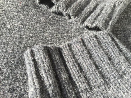cable stitch: Close-up photo of black grey knitted crumpled textured surface background