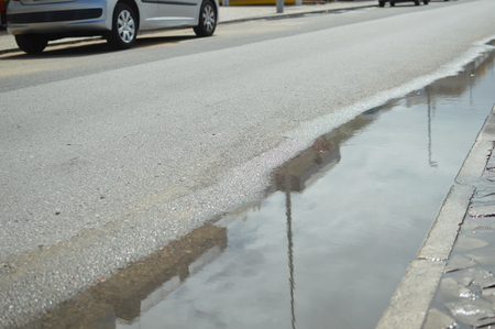 winter tires: Rain puddle on the road outdoor background