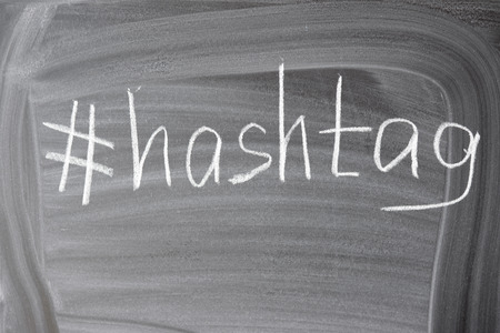 metadata: Closeup on hashtag symbol white chalk on a blackboard copy space background