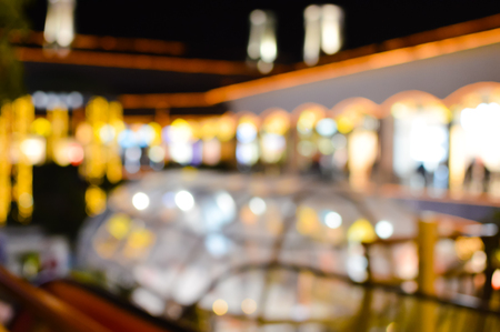 Abstract blurred bokeh urban street outdoors background, shallow depth of focus. Colorful defocused shiny night concept