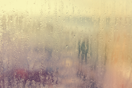 atmospheric pressure: Foggy condensated window blurry textured outdoors background image