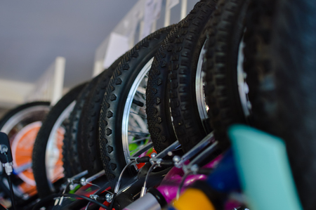 Close up on modern bikes detail over show room abstract shelf background, mobility cycle range Stock Photo