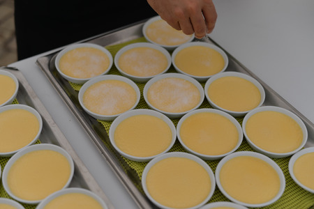 Custard making process, delicious decorated light table background, close up view Stock Photo