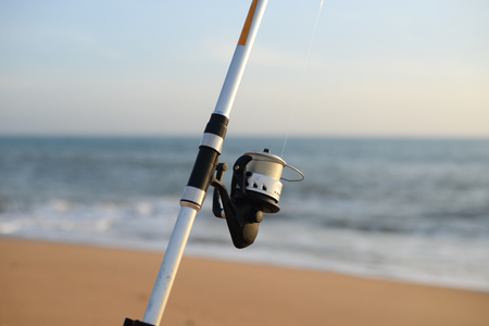 Closeup on fisherman rod on the sea coast background 免版税图像 - 100814823