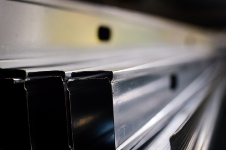 Close up of aluminium profile stacked steel background. Banque d'images