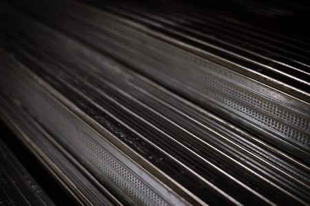 Close up of aluminium profile stacked steel background. industrial texture construction concept.