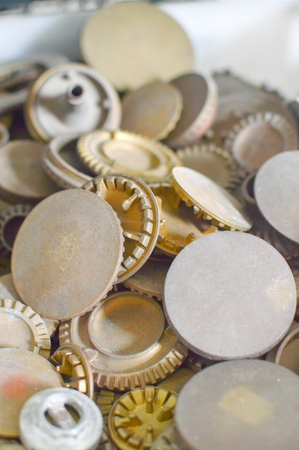 Gas plates spare parts for cooker, product shopping display background. Closeup on golden and gray shiny round shape elements of household appliance