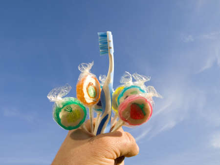 dentalcare: toothbrush with lollypops Stock Photo