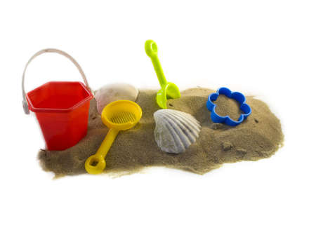 furlough: Toys and shells on the beach isolated