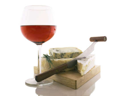 cheeses: A good glass of wine and different kinds of frech cheeses