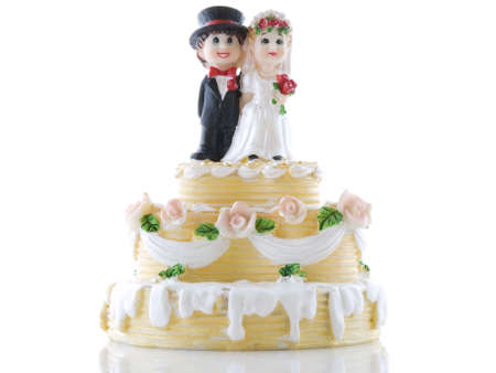 cake with icing: Wedding cake with bride and groom on a white background