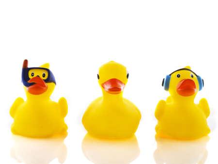 Three yellow bath ducks in a funny way Stock Photo