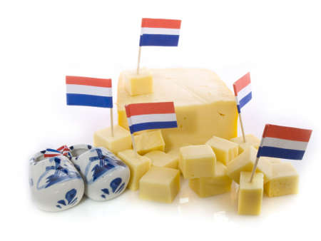 cutted: Dutch cheese cutted in pieces isolated on a white background