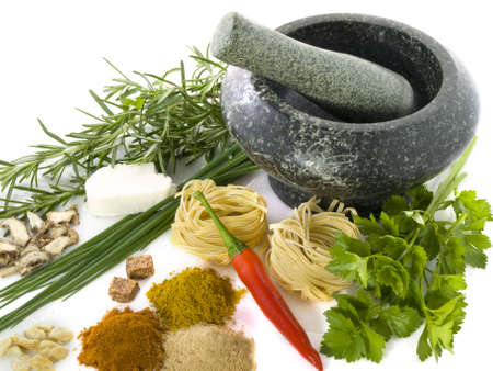 medical herbs: Mortar with different kind of herbs and spices