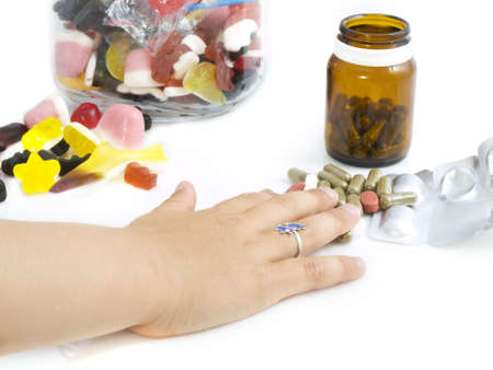 Little girls hand reaching for medicine instead of candy Stock Photo - 5061928