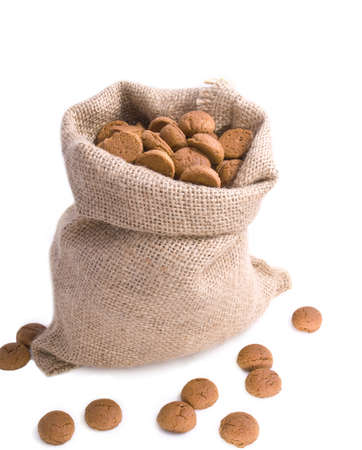 Bag filled with cookies on a white background