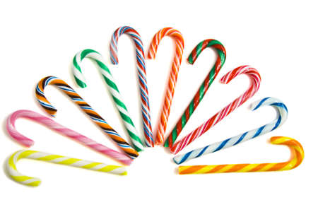 Colorful candy-canes in a row on a white background Stock Photo