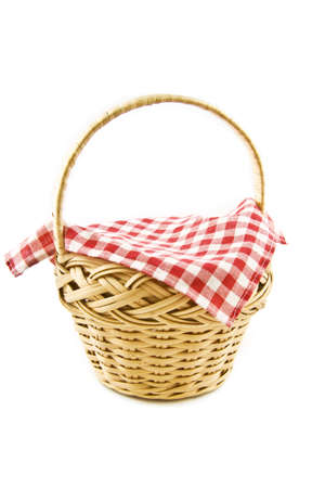 picknic: A rotan Picnic-basket with a table-cloth isolated on a white  background