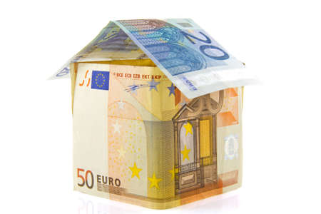 House made of euros isolated over white photo