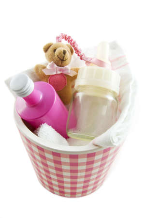 A blocked pink jar filled with baby-stuff isolated Stock Photo - 5918143