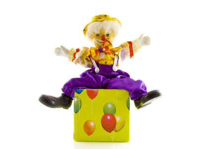 Clown sitting on a present decorated with balloons photo