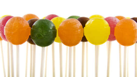 Colorful lollipops in a row on a white background