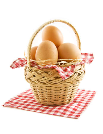 Basket filled with eggs isolated over white photo