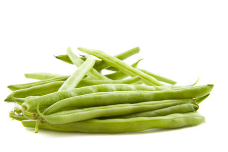 haricot vert: Green beans on a pile isolated over white
