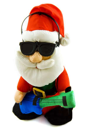 Santa with sunglasses and guitar isolated over white photo